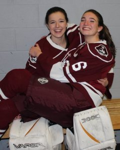 Seniors and Captains Katrina Menard and Kelly Gaudet have played four years of HHS Hockey .